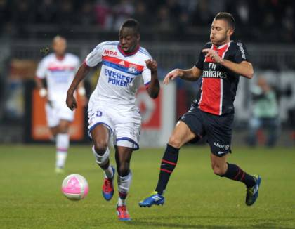Lyon's French defender Aly Cissokho (L)
