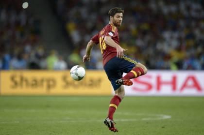 Spanish midfielder Xabi Alonso controls