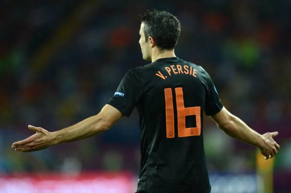 Dutch forward Robin van Persie holds his