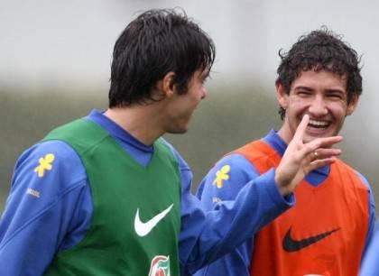 Brazilian player Kaka (L) jokes with tea
